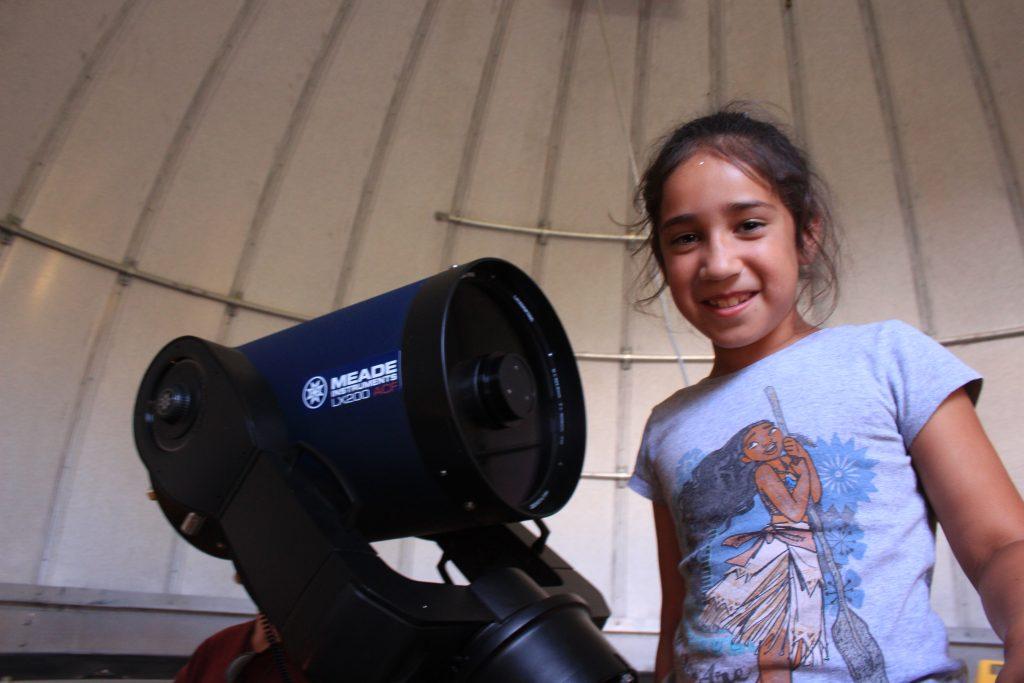 girl with telescope